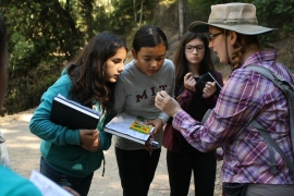 Geologist, Sara Beroff, demonstrates the different types of rocks throughout the Fire Trail in Berkeley.
