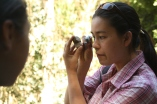 Geologist, Aurora Smedley, demonstrates how to use the loupe to see deeper into the rock.