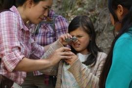 A DaVinci Camp scholar observes the wonders that lie inside the rocks.