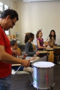 Musician, Jesus Martinez, leading the way for the scholars to follow with their drums.