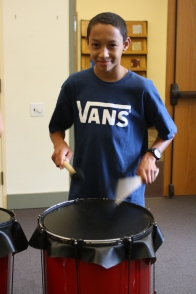 A scholar demonstrating that he does know how to play the drums.