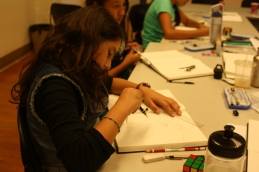 The scholars learn how to construct angle bisectors using just a compass and a straight edge.