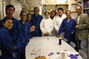 DaVinci camp scholars and campers pose with chemistry professor Nitash Balsara during their tour of the chemistry lab.