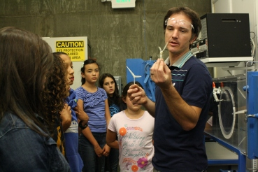 Alex Jordan, Senior Lab Mechanician at UC Berkeley's Hesse Hall, demonstrates how propellers printed from a 3-D printer can be tested using the wind tunnel behind him.