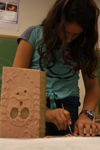 This scholar cuts the super sculpy into different designs to add 3-D patterns on the top of her box