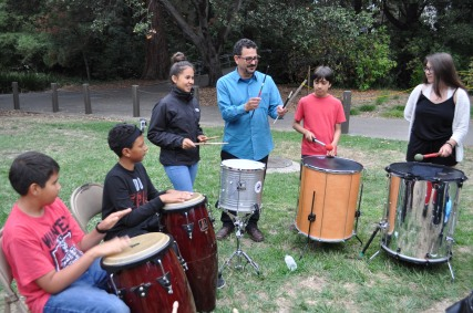 Scholars enjoy making music with their instructor, Jesus Martinez.