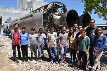 DaVinci Camp smiles in front of a huge missile at NASA Ames.