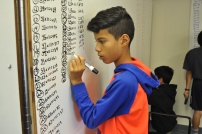 A young scholar works on multiplying by 11's.