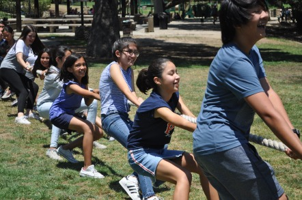 Scholars have fun playing a game of Tug-of-War.