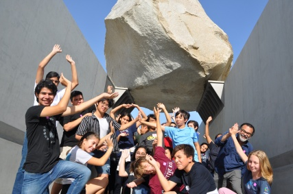DaVinci scholars try their hardest to hold up this huge rock!