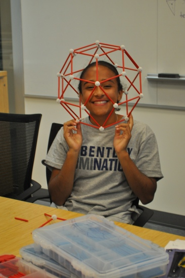 A young DaVinci has fun while creating polytopes with Zome Tools.